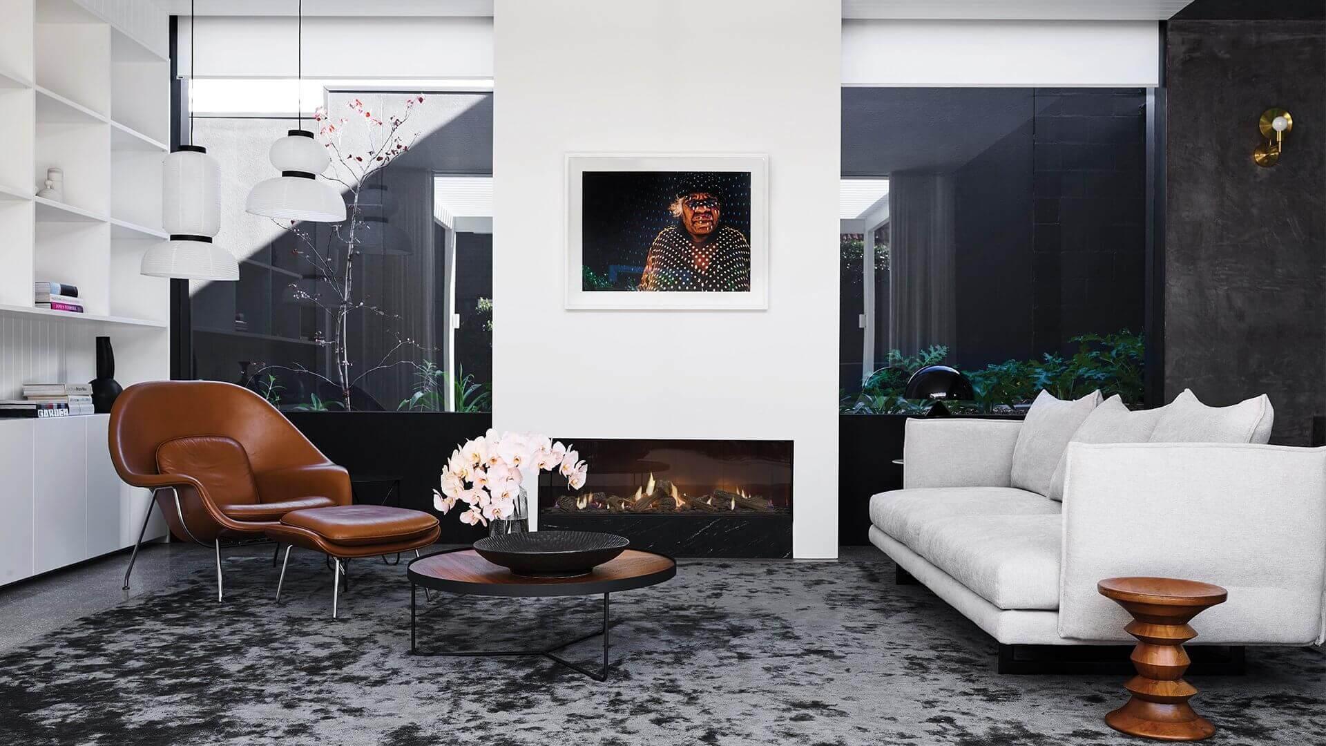 Large inbuilt wood heater in modern living room
