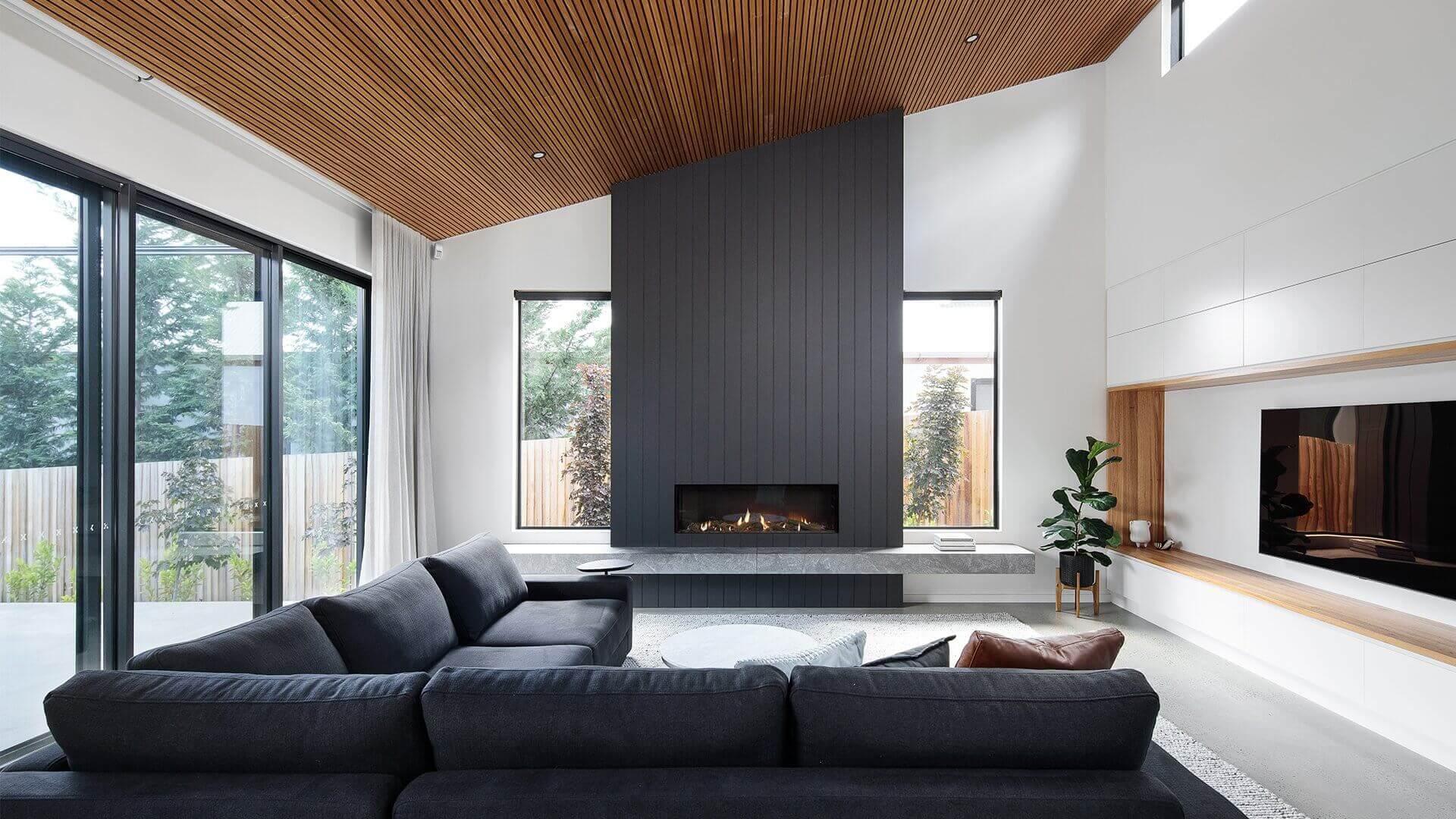 Inbuilt wood heater in large, modern living room