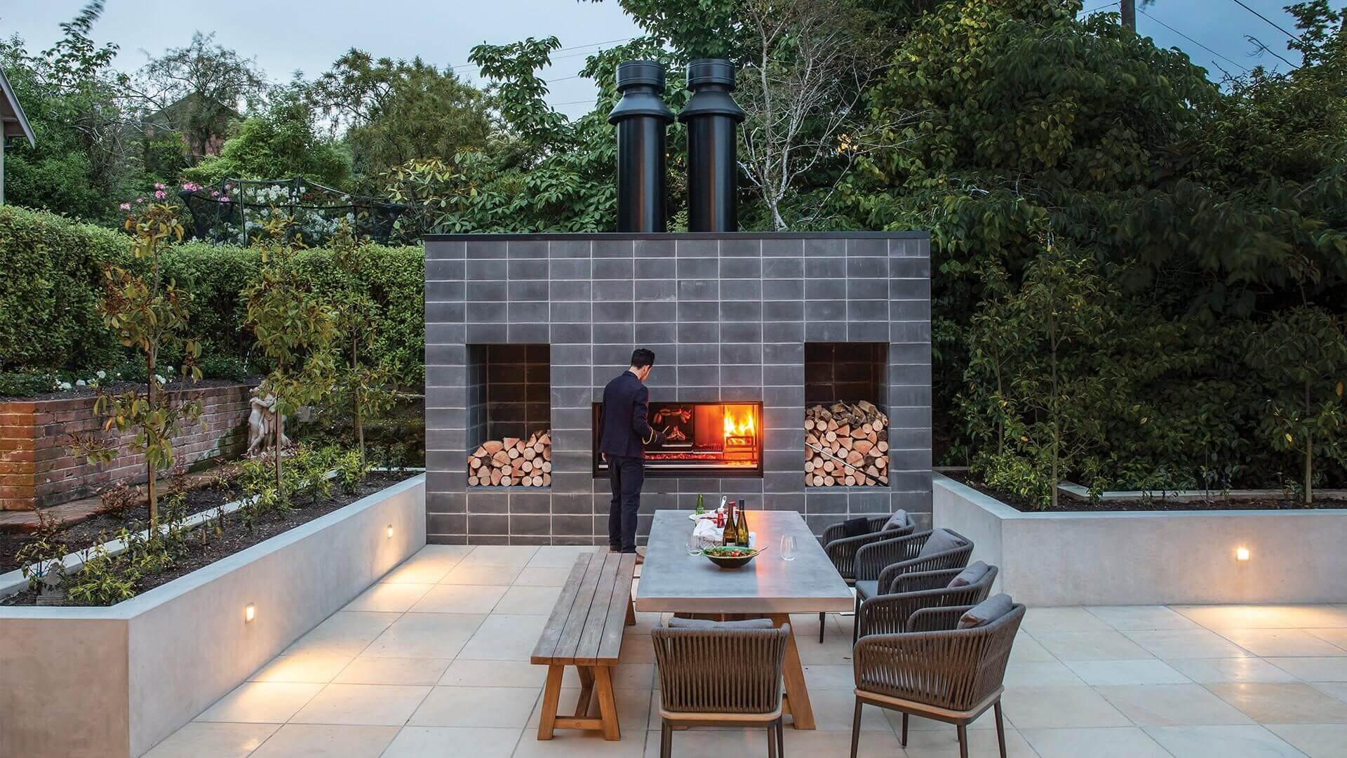 Render of man using outdoor wood heater on external patio
